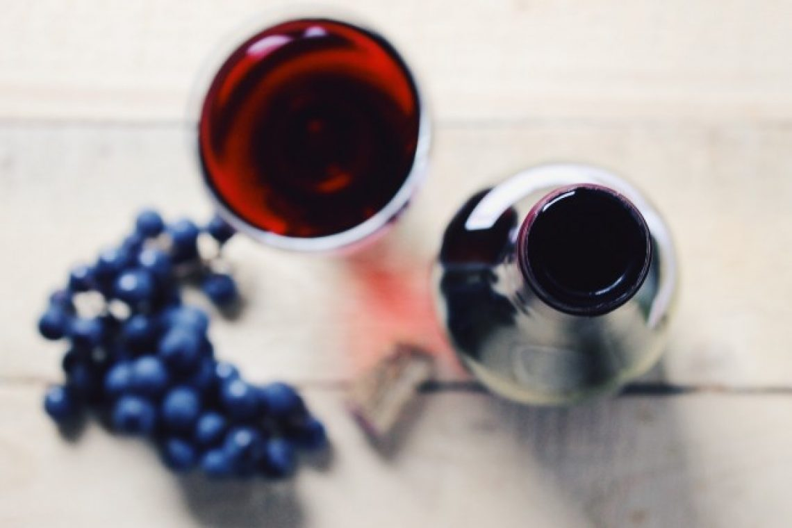 wine-bottle-glass-and-grapes-on-a-wooden-surface-the-top-view_t20_LQnjda